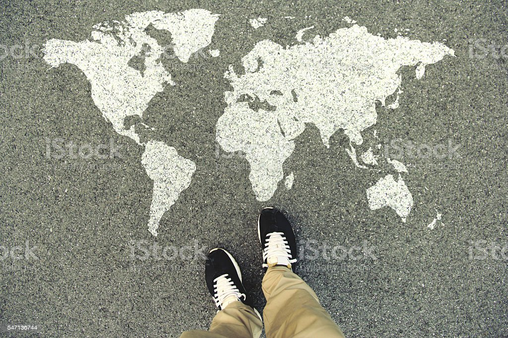 World map on an asphalt road stock photo
