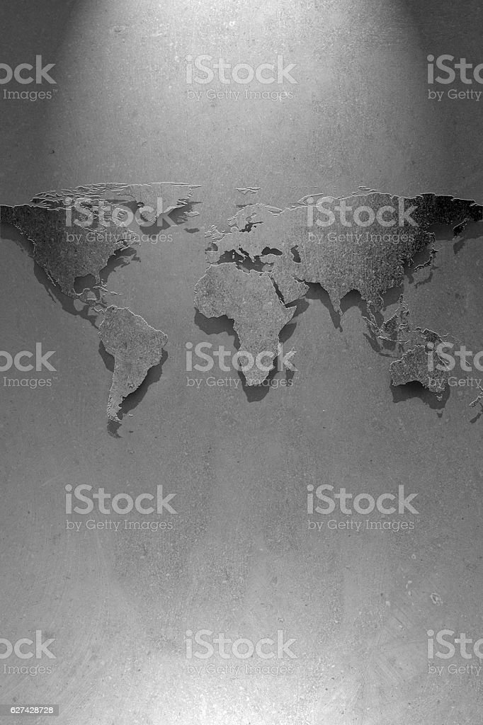 World map on concrete wall and one light spots stock photo