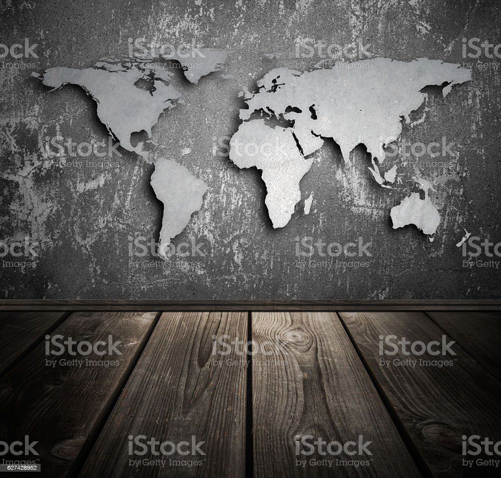 World map on concrete wall and wooden flooring - foto de acervo