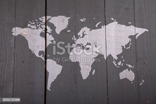 980314112istockphoto World map on dark black wooden background 505028398