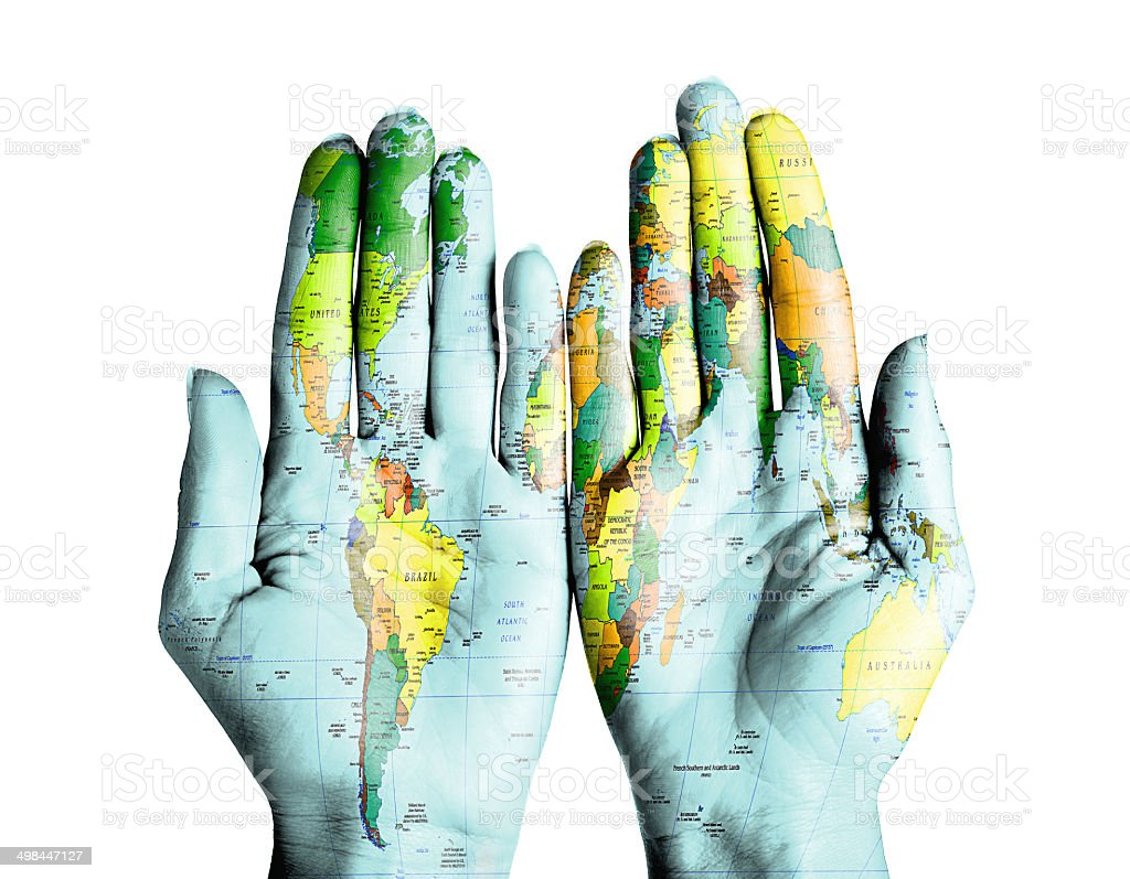 World map on palms of woman on isolated white background stock photo