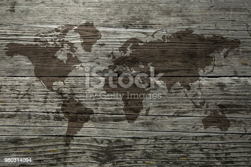 980314112 istock photo World map on the boards 980314094
