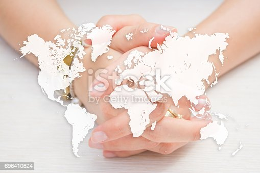 istock World map on woman crossing hands background. Human resources concept. Hiring poster or flyer design 696410824