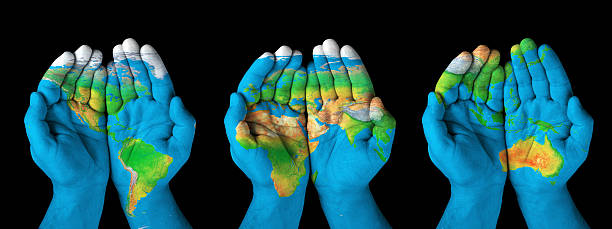 World map painted on hands Map painted on hands showing concept of having the world in our hands. body paint stock pictures, royalty-free photos & images