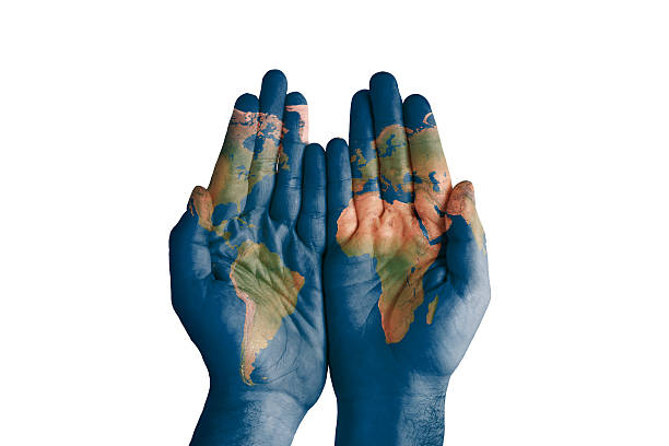 Royalty free world map painted on hands pictures images and stock world map painted on hands stock photo gumiabroncs Images