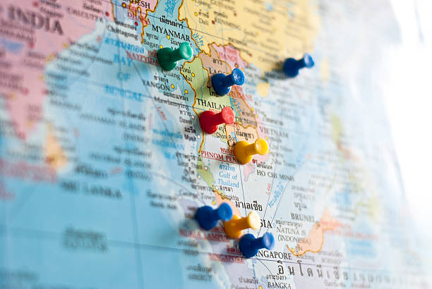 World map with colorful pins Pins mark on Southeast Asia countries. straight pin stock pictures, royalty-free photos & images