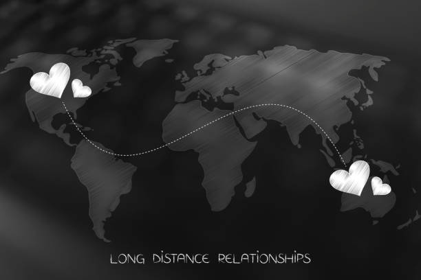 world map with lovehearts connected by dashed line across continents long distance relationship concept: world map with lovehearts connected by dashed line across continents long distance relationship stock pictures, royalty-free photos & images
