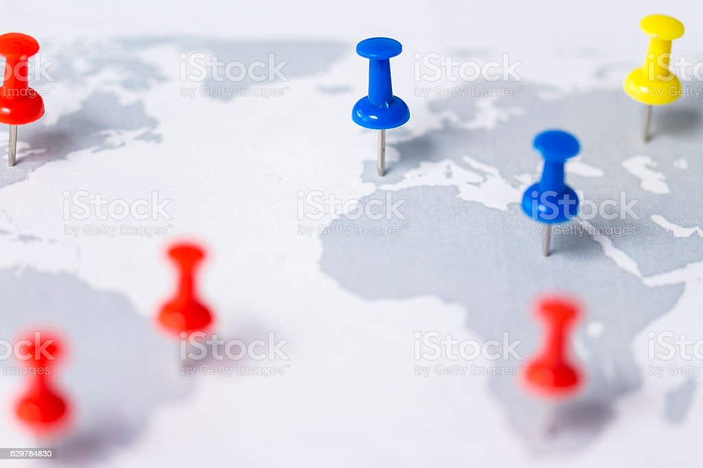 World map with push pins stock photo
