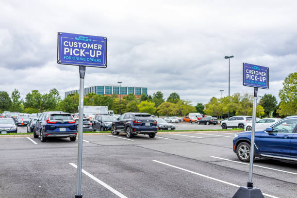World Market parking lot store sign by entrance of store in Loudoun county, Virginia stock photo