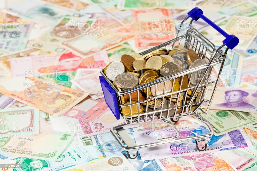 World Money In A Shopping Cart royalty-free stock photo