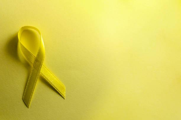 prevenção do suicídio do mundo e fita da consciência do cancro da infância do dia. - setembro amarelo - fotografias e filmes do acervo