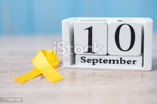 World Suicide prevention day ( 10 September), Yellow Ribbon for supporting people living and illness. Stop and Save Suicidal concept