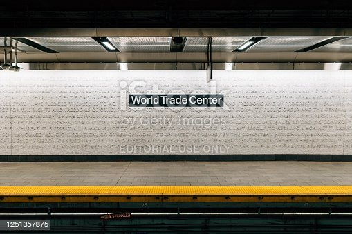 New York, NY, USA - May 28, 2019: Frontal view of the World Trade Center subway platform of Cortlandt Station. Part of The Oculus, the World Trade Center Transportation Hub for the PATH in New York City. Decoration of the wall is a mosaic created by Ann Hamilton and Mayer of Munich, a visual tribute to words that represent the foundamental values of our society