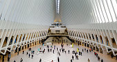 New York: World Trade Center Transportation hub interior with people walking towards the subway