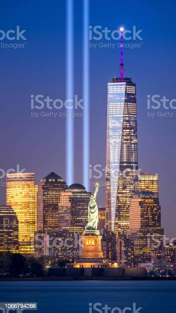 Photo of World Trade Center with Statue of Liberty on the foreground