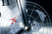 detail of a retro clock with timezones and plane.