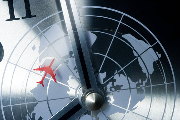 World travel concept detail of a retro clock with timezones and plane. jet lag stock pictures, royalty-free photos & images