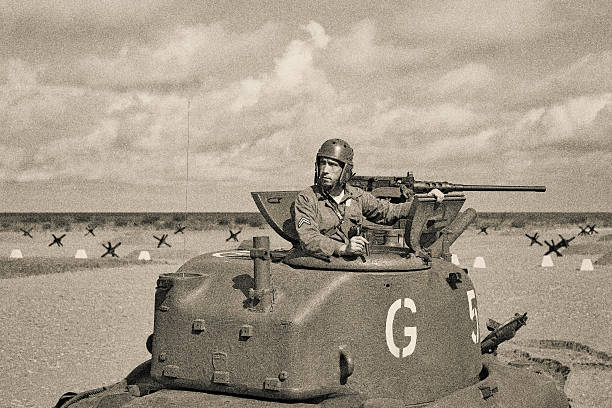 World War 2 Armored Tank on Beach World War 2 M5 Stuart Tank and Tank Crew. 50 caliber machine gun. Anti tank obstacle on beach. Lots of extra bleed of multiple cropping options. normandy stock pictures, royalty-free photos & images