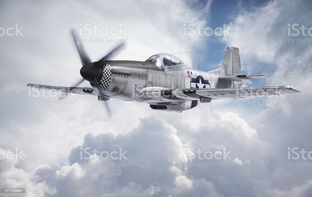World War 2 P-51 Mustang fighter plane flying among clouds stock photo