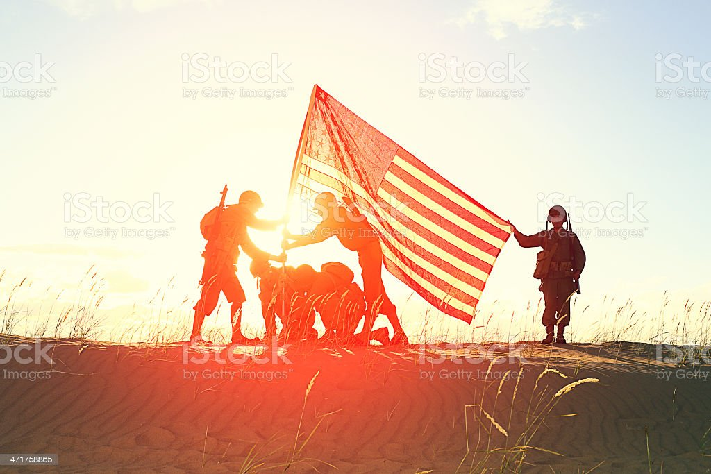 World War 2 Soldiers with American Flag royalty-free stock photo