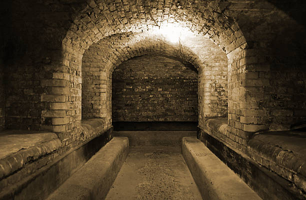 World War II British underground bunker Underground bunker from an old WWII fort near Felixstowe on the south coast of England. bomb shelter stock pictures, royalty-free photos & images