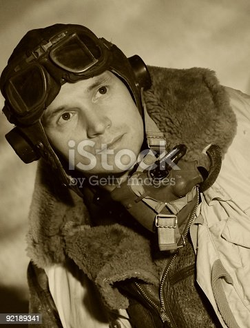 Contemporary sepia toned portrait taken in vintage style. The model is wearing original WW2 RAF uniform and equipment.
