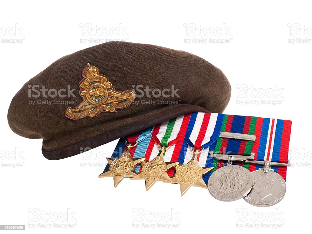 1945: World War II soldier's beret and medals stock photo