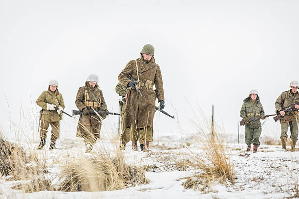 world war ii soldiers in the snow - world war ii stock photos and pictures