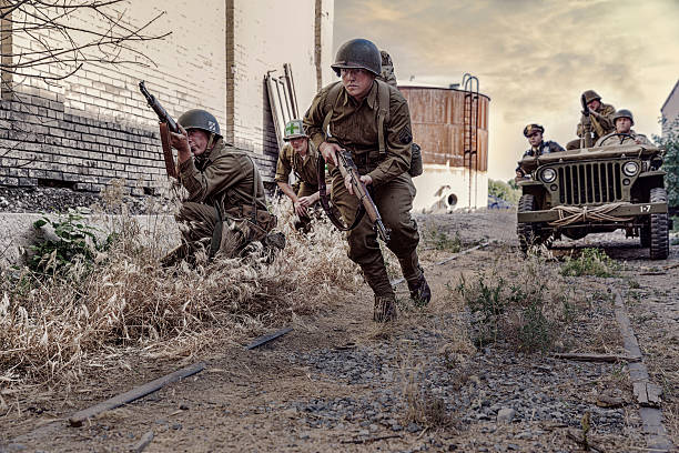 world war ii soldiers looking for the enemy - world war ii stock photos and pictures