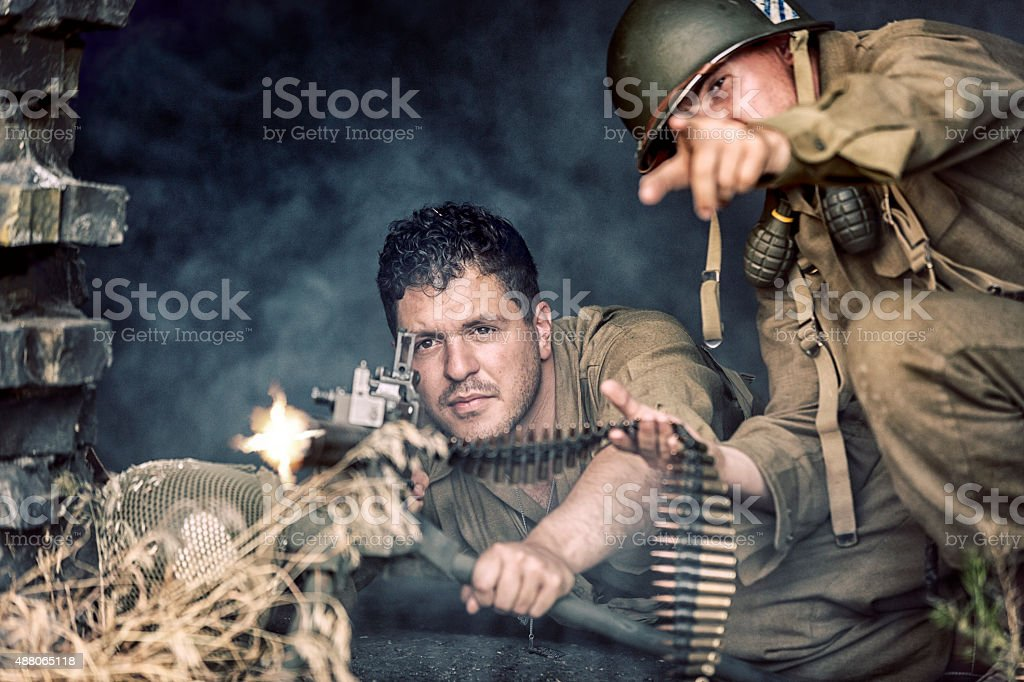 World War II US Army Soldier Firing a 50 Caliber stock photo