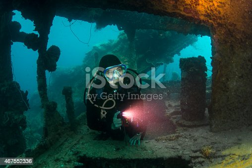 A diver explore the ruins of the Helmet Wreck, a Japanese battleship sunken during Desecrate I raid - 1944, Palau - Micronesia