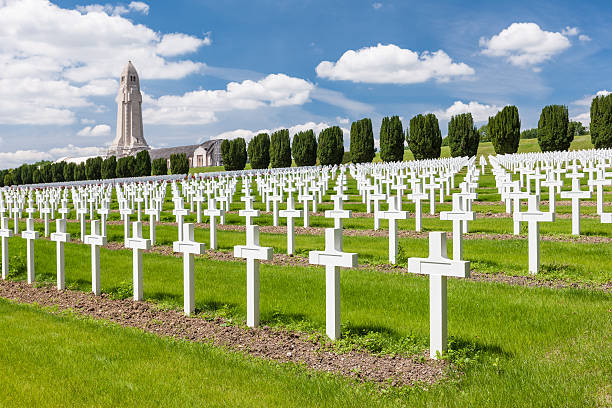 World War One cemetery at Verdun France War cemetery north east of Verdun in France commemorating those who died during the Battle of Verdun in 1916. The building behind the cemetery is the Ossuary of Douaumont containing the skeletal remains of at least 130,000 unidentified soldiers. verdun stock pictures, royalty-free photos & images
