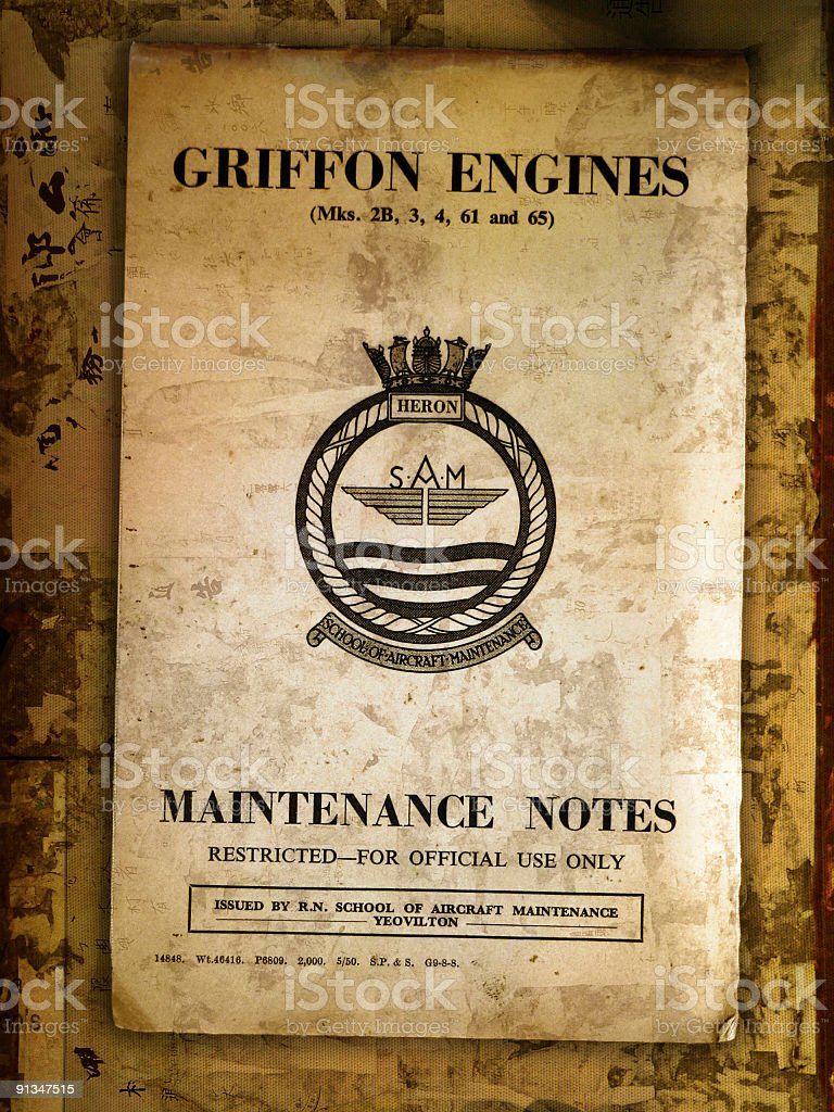World War Two Aircraft Engine Maintenance Book on old desk royalty-free stock photo