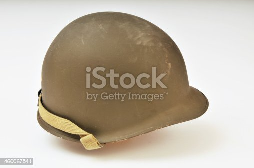 M1 steel helmet as worn by the US forces during World War Two. Studio shot with a plain background.