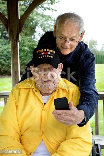 Senior veteran in wheel chair wondering, taking selfie. Image shot with Canon 5D Mark lv, 24-105mm f/4L IS USM lens.