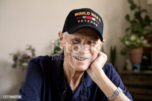 Elderly veteran sitting at home in a pleasant mood.