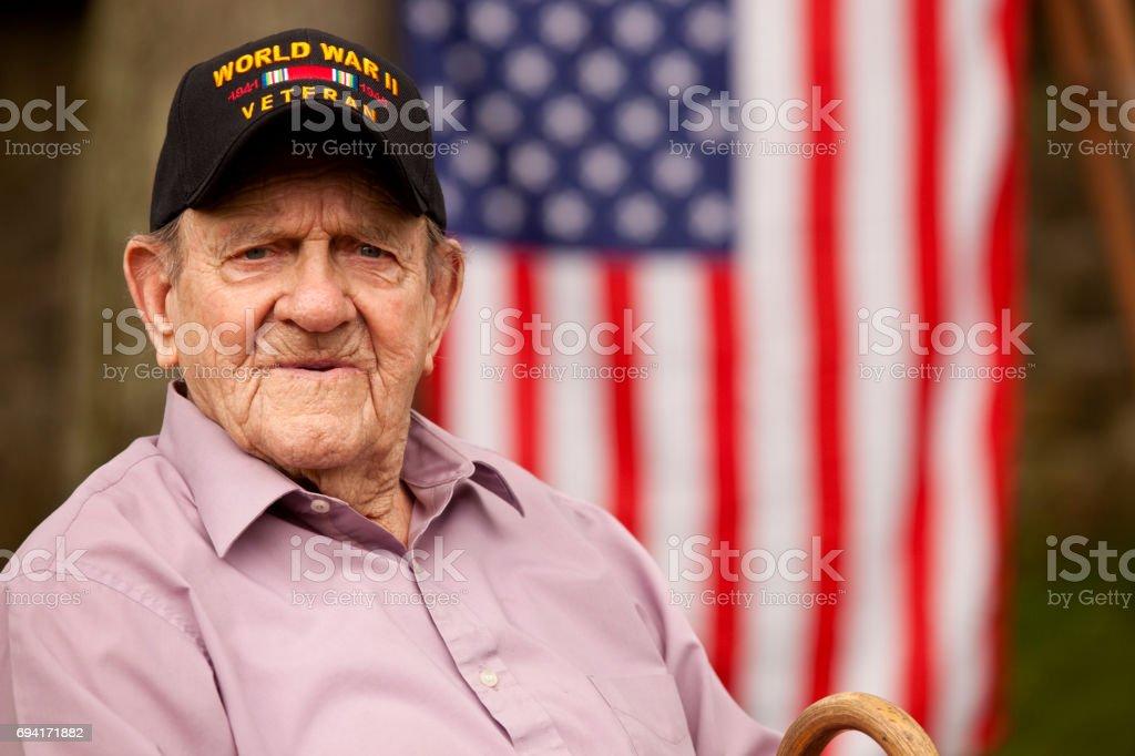 . World War Two, Veteran wearing  baseball cap with text,' World War Two Veteran'. Sitting stock photo