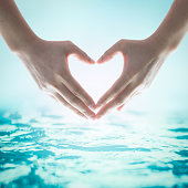 World water day concept with hands in love heart shape concept