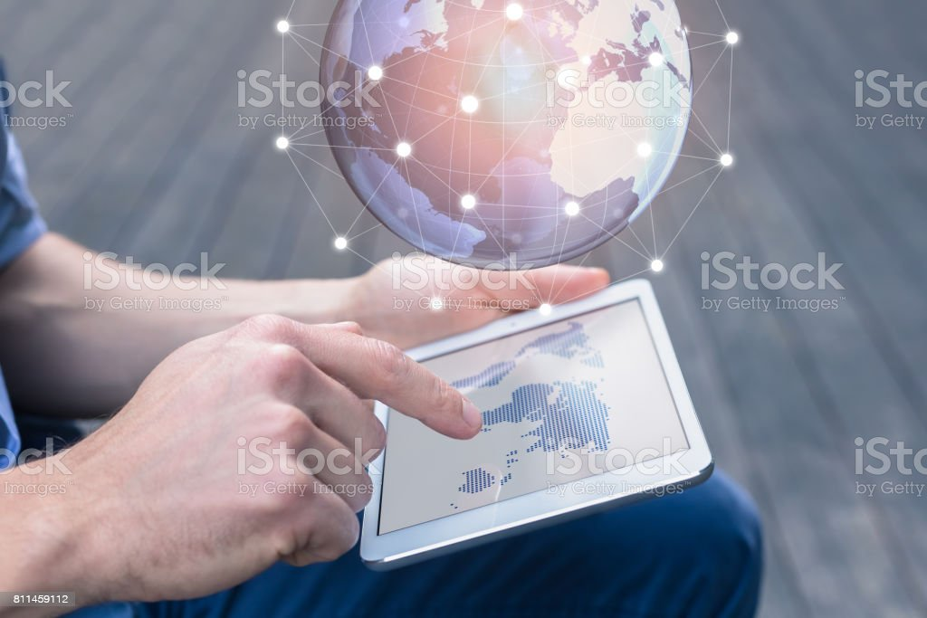 World wide business concept, person using AR tablet, 3D globe stock photo