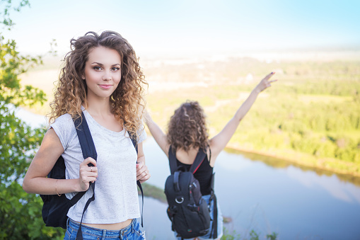 483422527 istock photo A world without borders. Stunning journey of two girls in the mountains. Two girls at the top of the mountain rejoice in a successful ascent. Concept of success and travel 1155167499