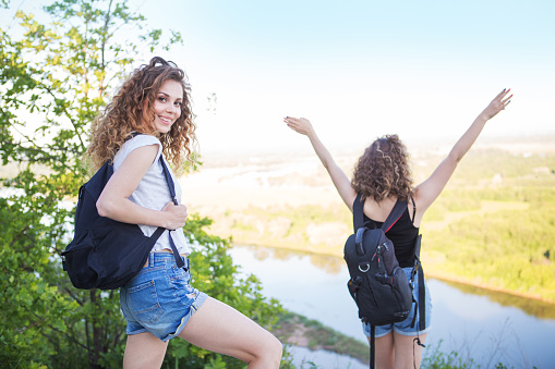 483422527 istock photo A world without borders. Stunning journey of two girls in the mountains. Two girls at the top of the mountain rejoice in a successful ascent. Concept of success and travel 1155167560