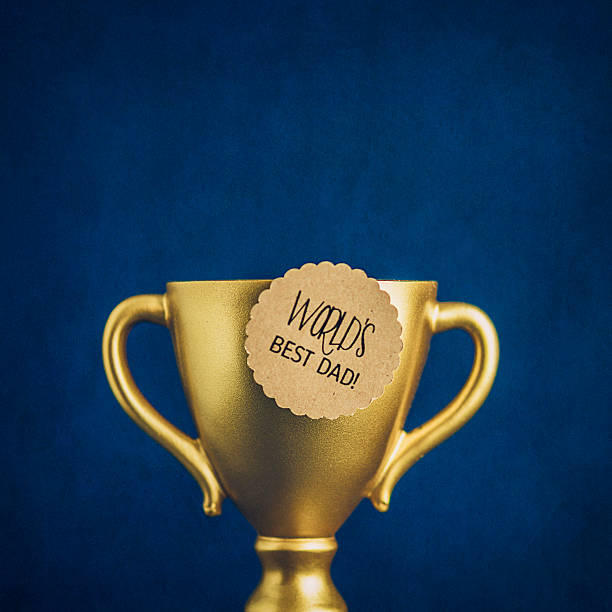World's Best Dad Award with gold trophy. Father's Day stock photo