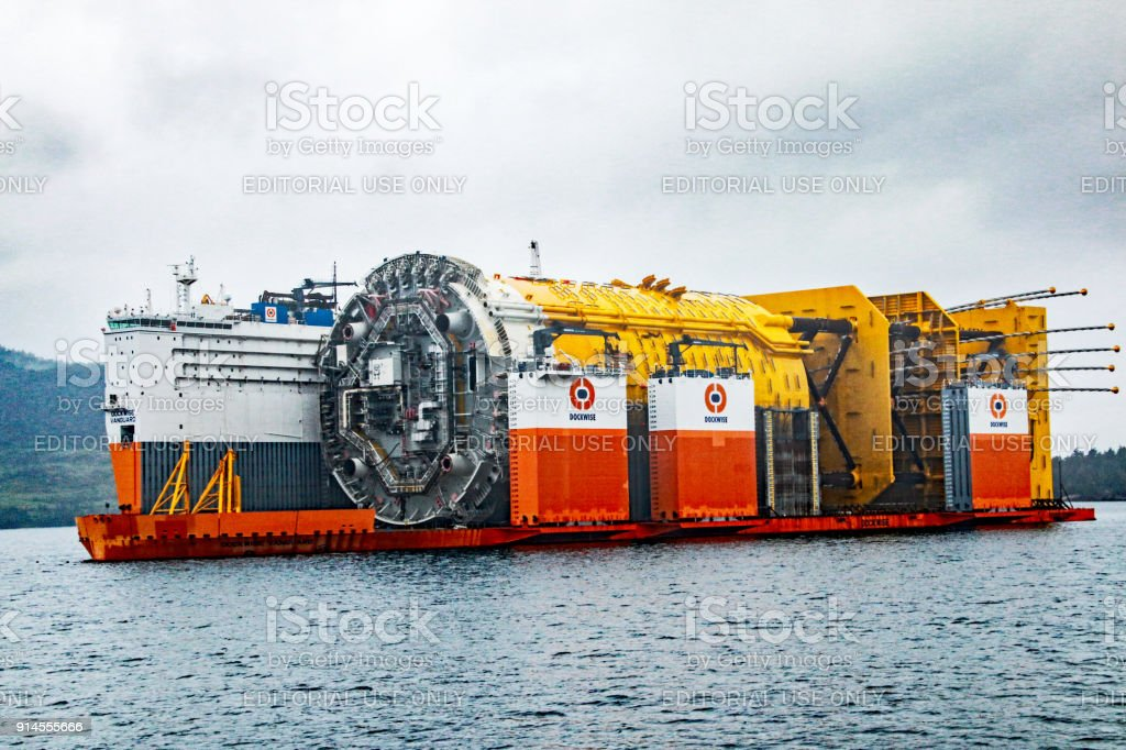 World's largest spar floater being transported by the world's largest heavy transport vessel, Dockwise Vanguard, to the deepater site near Stord. stock photo