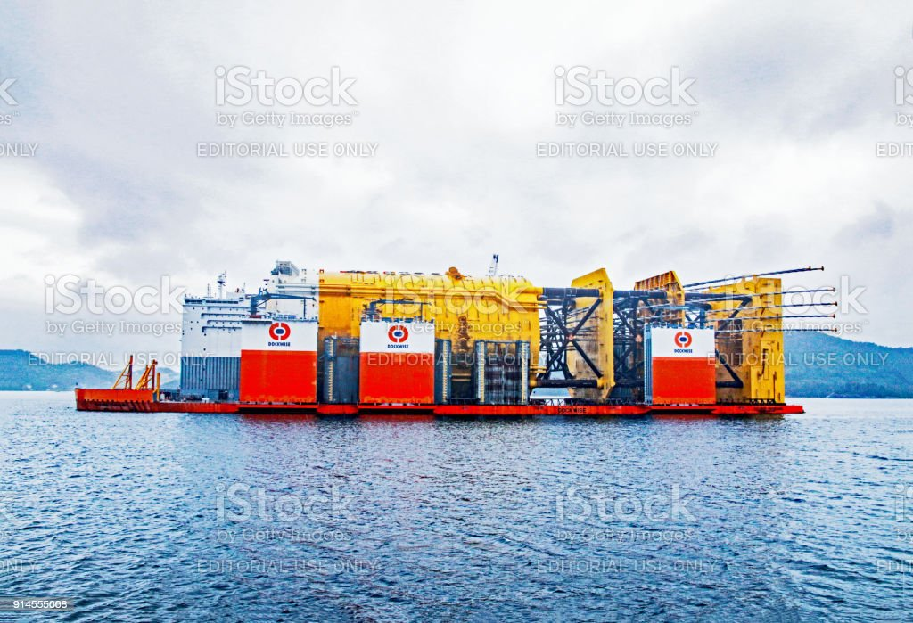 World's largest spar floater on transport to deepwater site near Stord by the world's largest heavy transport vessel, Dockwise Vanguard. stock photo