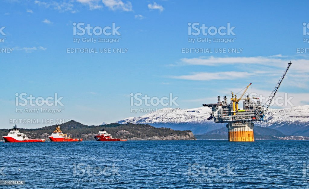 World's largest spar floater platform has just started the tow out phase of 12 days to Aasta Hansteen gas field from deepwater site at Stord, Norway stock photo