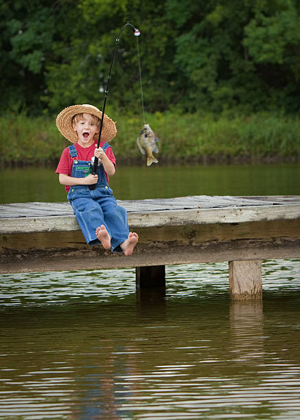 World's Most Excited Little Fisherman  bib overalls boy stock pictures, royalty-free photos & images