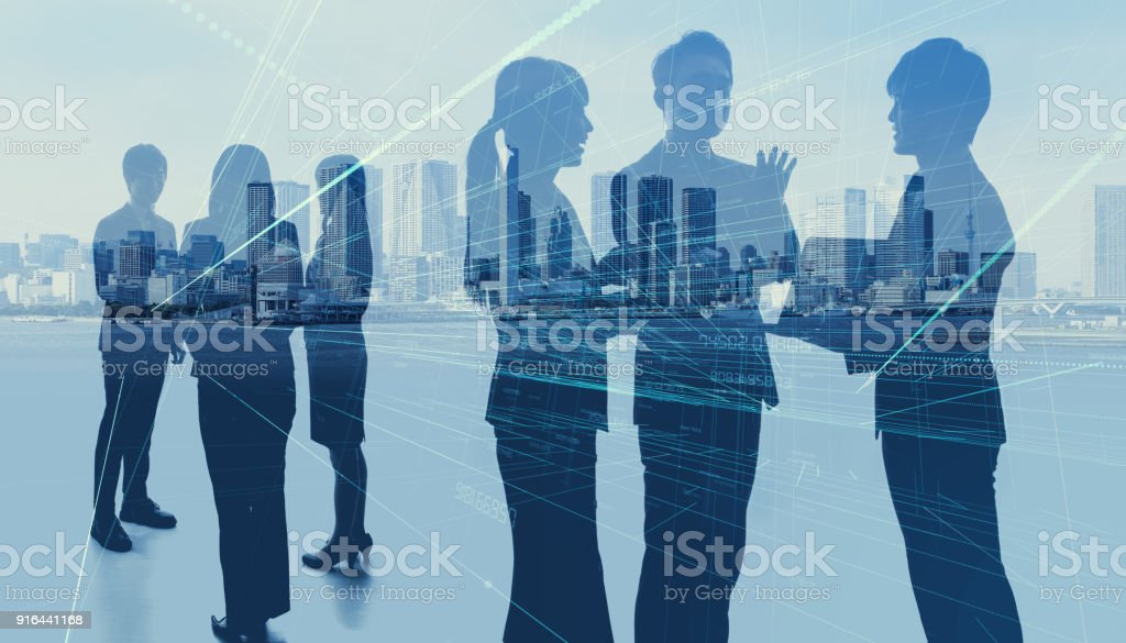 Worldwide business concept. Silhouettes of business persons. stock photo