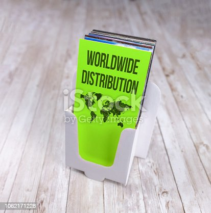 1062171194 istock photo Worldwide Distribution in a leaflet rack with map 1062171228
