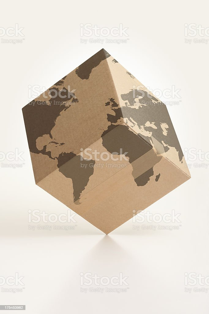Worldwide logistics cardboard box and world map royalty-free stock photo