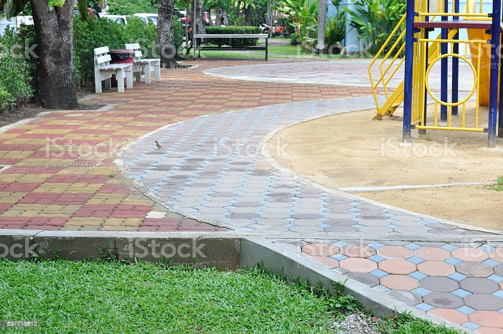 Worm blocks for walkway and green yard. stock photo